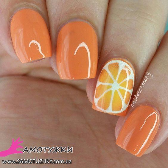Маникюр с оранжевым рисунком