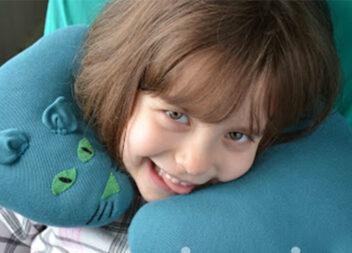 Ідея для подорожей: подушка під шию для дитини